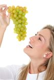 Woman eating grapes Royalty Free Stock Image