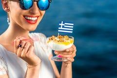 Woman eating greek yogurt Royalty Free Stock Photo