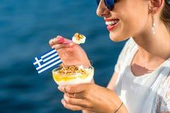 Woman eating greek yogurt Stock Image