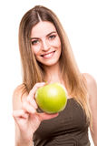 Woman eating green apple Stock Images