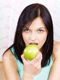 Woman eating green apple Stock Image