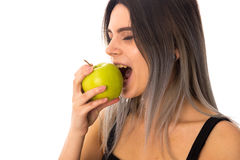 Woman eating green apple Stock Photography