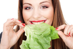 Woman eating green salad Stock Photos