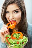 Woman eating green salad . Female model close up face studio is Stock Photo