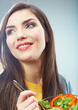 Woman eating green salad . Female model close up f Royalty Free Stock Photos