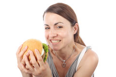 Woman eating hamburger Royalty Free Stock Image