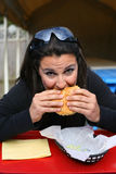 Woman eating a hamburger Stock Photo