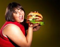 Woman eating hamburger. stock photos