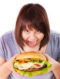 Woman eating hamburger. stock photo