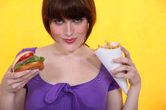 Woman eating hamburger Royalty Free Stock Images