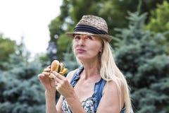 Woman eating a hamburger Royalty Free Stock Images