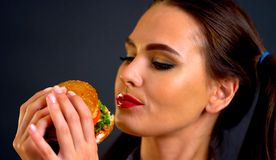 Woman eating hamburger. Girl wants to eat fast food. royalty free stock images