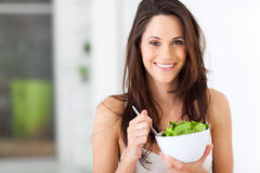 Woman eating healthy Royalty Free Stock Image