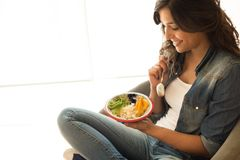 Woman eating a healthy bowl. Of superfoods stock image