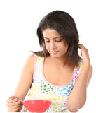 Woman eating healthy breakfast cereal Stock Photo