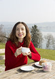 Woman eating a healthy breakfast outdoors Royalty Free Stock Photo