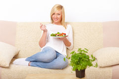 Woman eating healthy food Stock Image