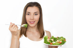 Woman eating healthy food, Caesar salad Royalty Free Stock Photography