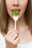 Woman eating healthy food concept Stock Image