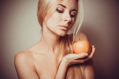 Woman eating healthy food. Detox concept: young blonde woman under 30 closeup portrait with beautiful skin Royalty Free Stock Photos