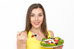 Woman eating healthy food, Greek salad Stock Photo