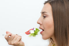 Woman eating healthy food, Greek salad Royalty Free Stock Images