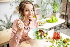 Free Woman Eating Healthy Green Food Stock Photos - 110356333