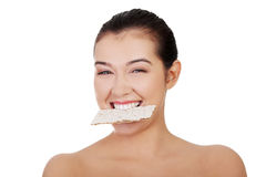 Woman eating healthy rye cracker bread Stock Image