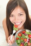 Woman eating healthy salad royalty free stock photos