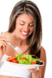 Woman eating a healthy salad Stock Photo