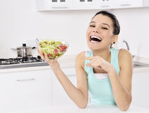 Woman eating healthy salad Royalty Free Stock Photo