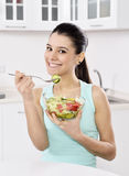 Woman eating healthy salad Stock Photography