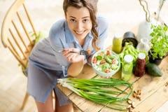 Woman eating healthy salad stock photos