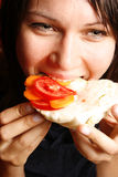 Woman eating a healthy sandwich Royalty Free Stock Images