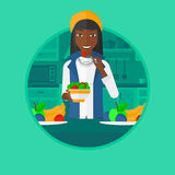 Woman eating healthy vegetable salad. Royalty Free Stock Photos