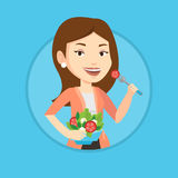 Woman eating healthy vegetable salad. Royalty Free Stock Images