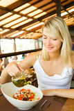 Woman eating healthy vegetables Stock Images