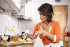 Woman eating her breakfast Royalty Free Stock Photography