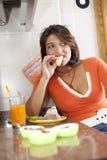 Woman eating her breakfast Stock Image