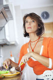 Woman eating her breakfast Royalty Free Stock Image