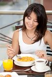 Woman eating her breakfast Stock Photo