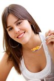 Woman eating her breakfast Stock Images