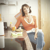 Woman eating her breakfast Royalty Free Stock Photo