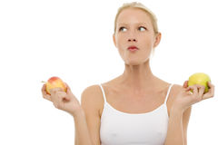Woman eating and holding apples in the hands Stock Photography