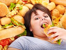 Woman eating hot dog. Stock Photography