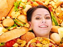 Woman eating hot dog. royalty free stock photos