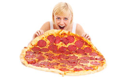 Woman eating huge pizza