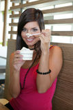 Woman eating an ice-cream. Stock Images