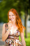 Woman eating ice-cream Stock Image