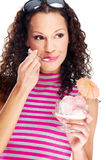 Woman eating ice cream. Decorated with orange umbrella, wearing shirt with pink and gray horizontal stripes, isolated Stock Photography